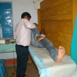 Biswajit Sahoo, Physiotherapist checking a patient