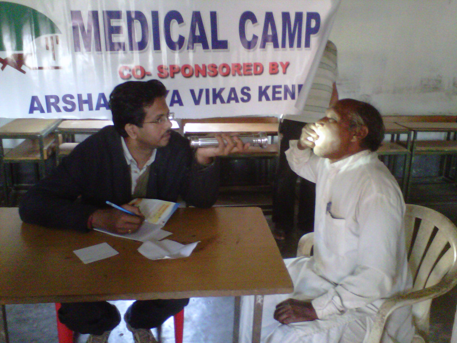 Dr. Abhilash Mohapatra attending to a patient