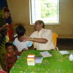 Dr. Bimal Chandra Rath attends to a patient