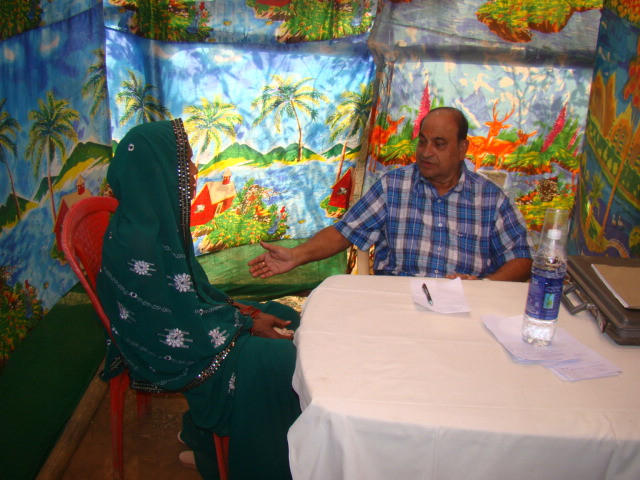 Dr. Dharanidhara Mishra attending to a patient