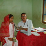 Dr. P C Mohanty attending to a patient