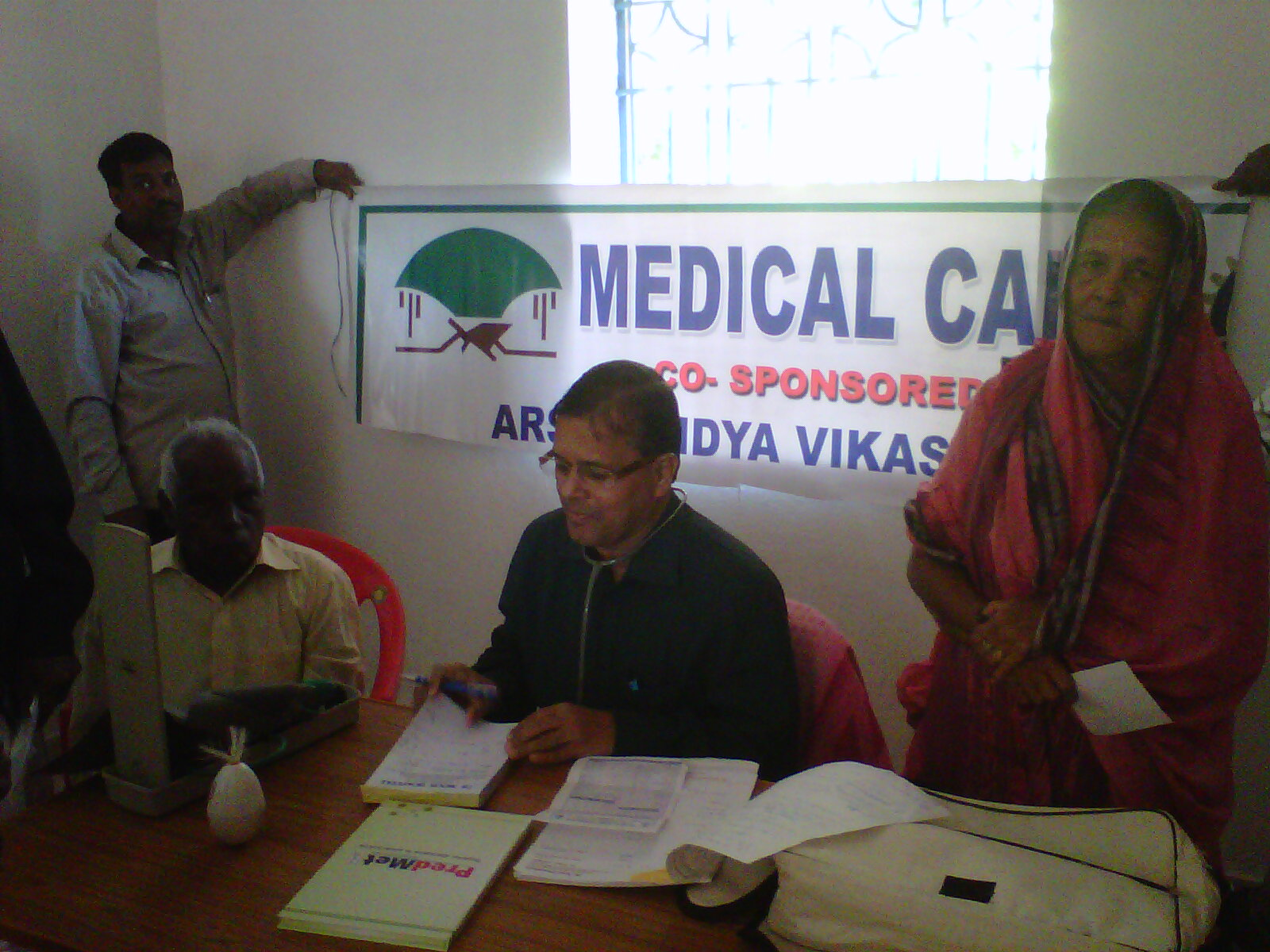 Dr. P C Mohanty attending to patients