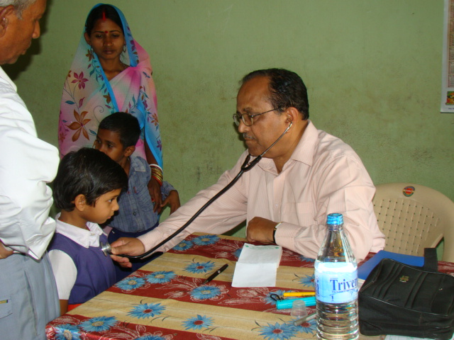 Dr. S N Kar attending to a patient