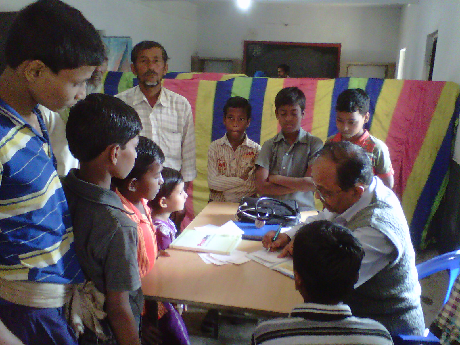 Dr. S N Kar, Paediatriciian surrounded by children