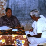 Prof. Dharanidhara Mishra attending to a patient