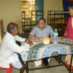 Prof. Dharanidhara Mishra attends to a patient