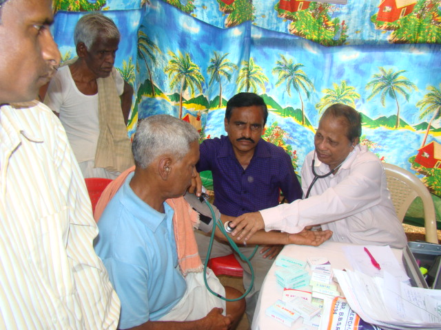 Prof. R N Sahoo attending to a patient