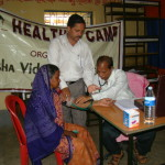Prof. R N Sahoo attends to a patient