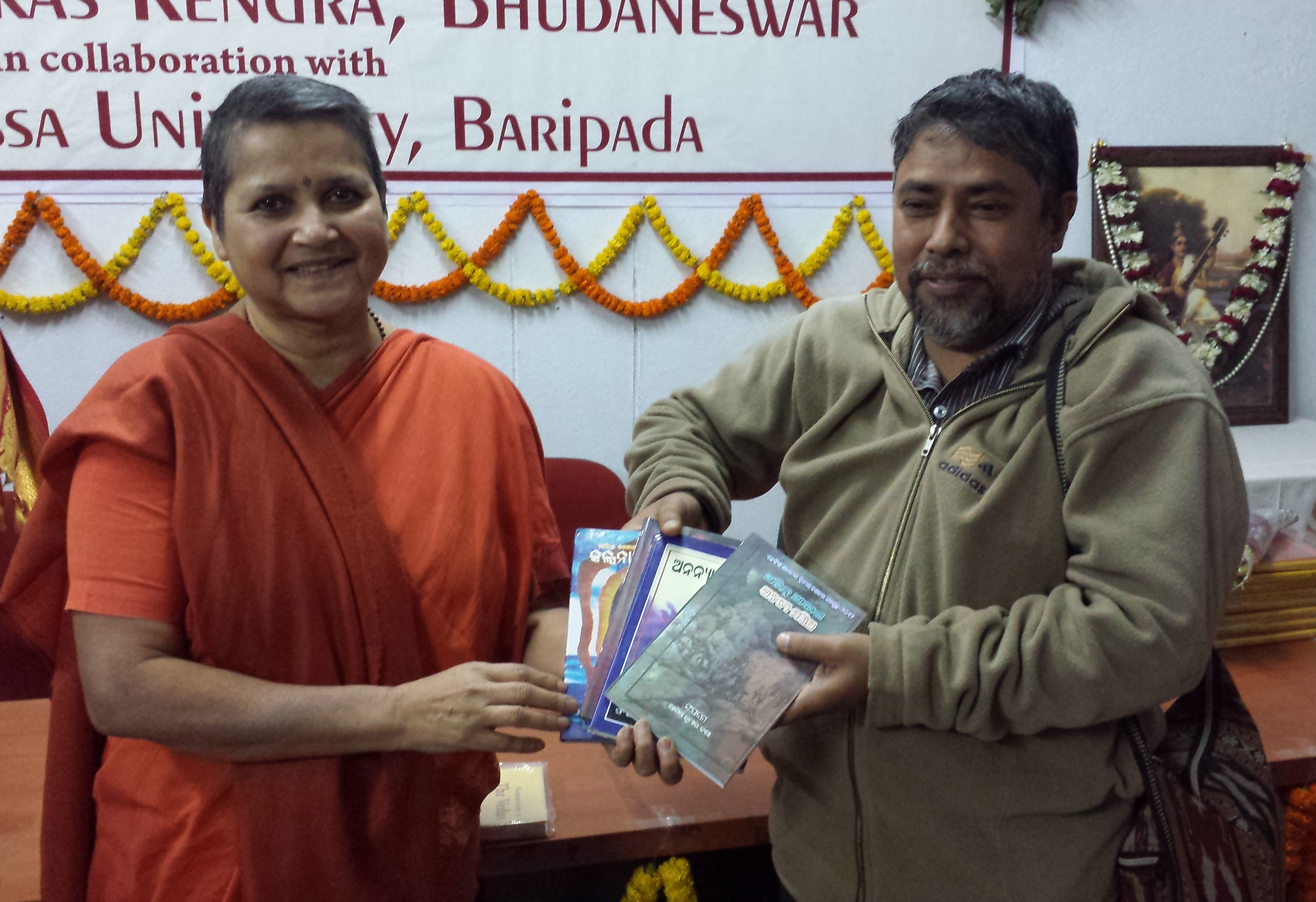 A Poet gifting his books to Swamini