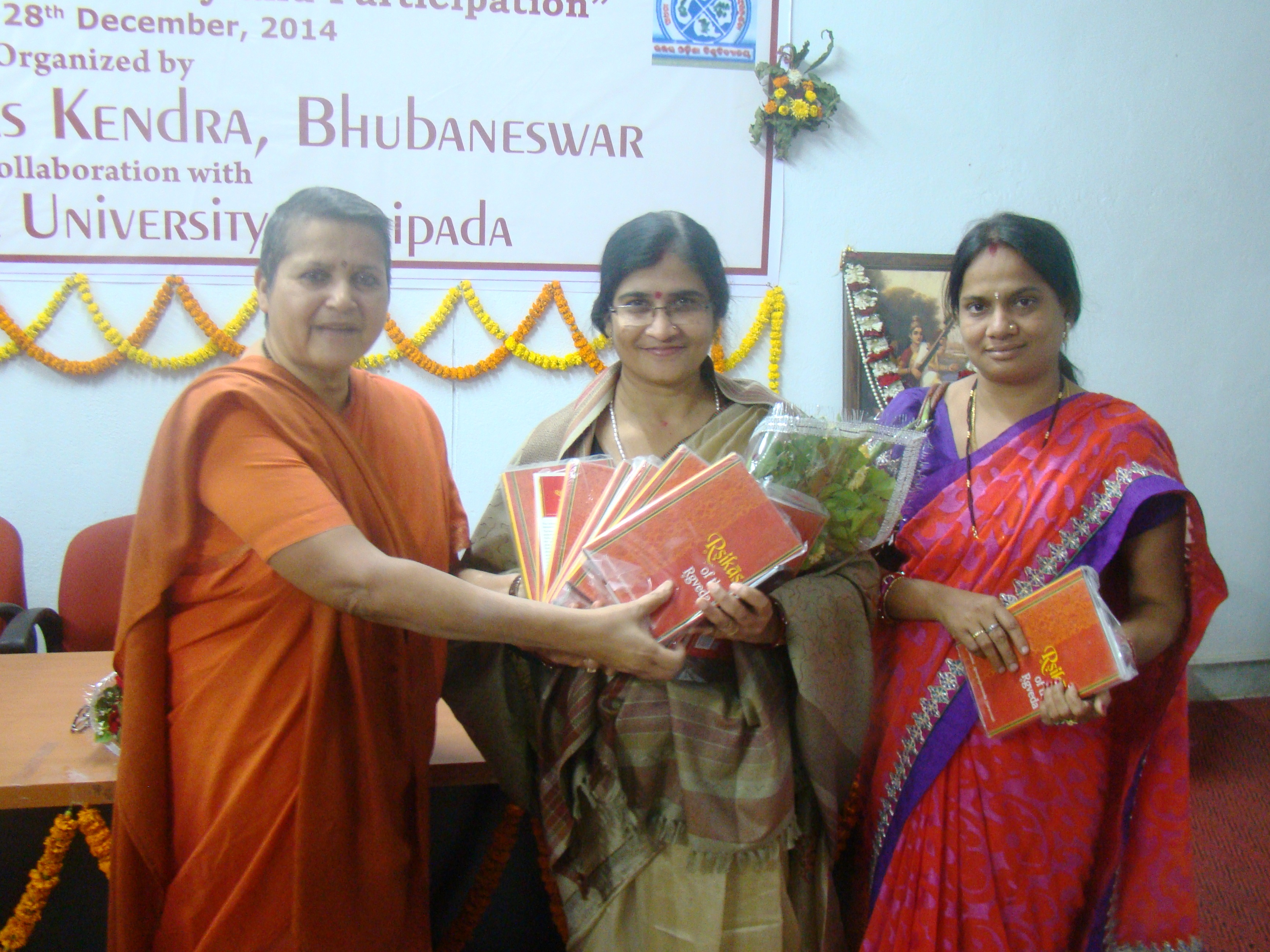 Swamini gifting her book - Rshikas of the Rgveda to the women poets